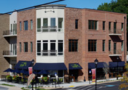 Case Study: Vinyl Windows at Mixed-Use Space Withstand Humidity, Maintain Visual Charm